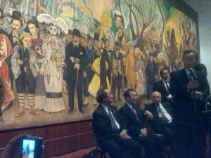 Paul Kawika Martin snaps picture of UN Secretary-General Ban Ki-Moon in front of Diego Rivera mural