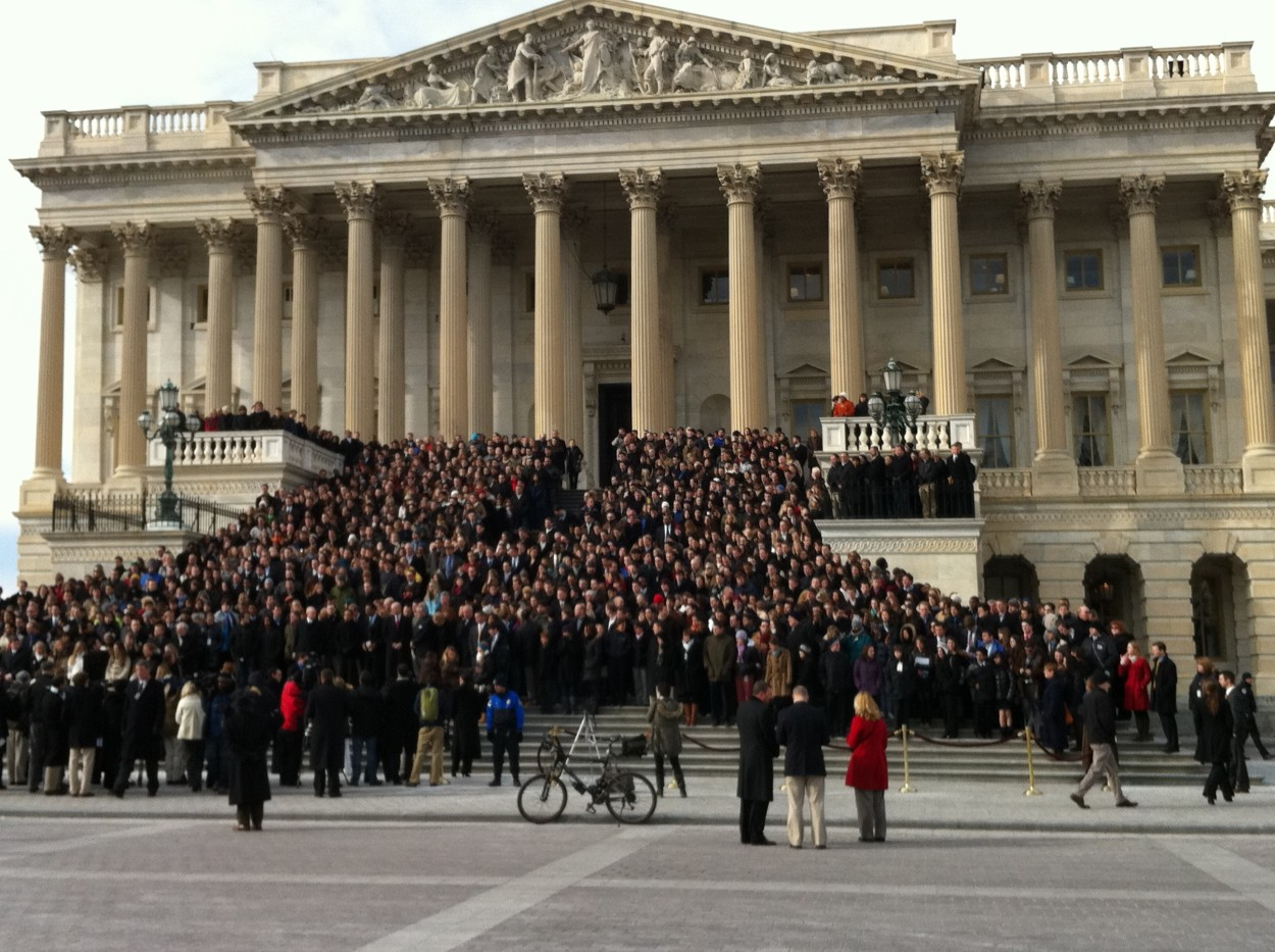 Congressional staff gathered on the Capitol steps Monday for the moment of silence honoring the victims of the Arizona shooting.