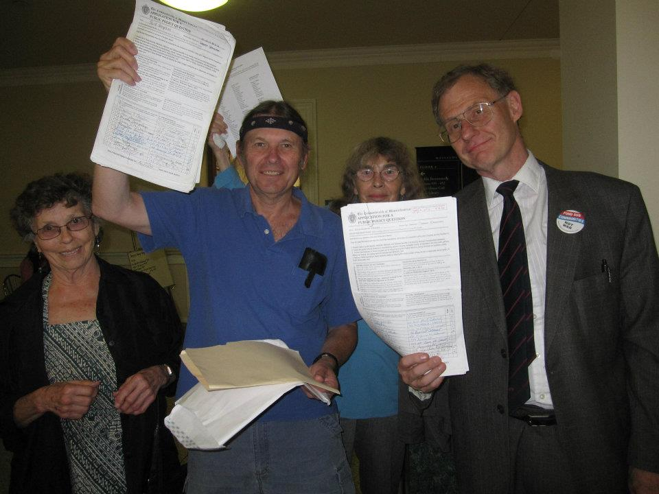 Audley Green, Paul Shannon, Shelagh Foreman and Cole Harrison at Massachusetts State House turning in the nearly 20,000 signatures to place the Budget for All referendum on the ballot.